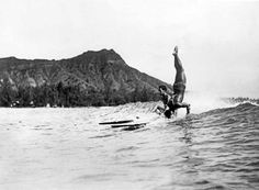 Old hawaiian surfers | 1925 - a surfer at Waikiki Beach stands on his head as he rides a wave ...