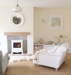 Bringing a coastal theme to life with a duck egg palette and log burner fire Cream Living Rooms, Cottage Living Rooms, Coastal Living Rooms, Living Room On A Budget, Cottage Interiors, Home Living Room, Living Room Decor, Living Spaces, Log Burner Living Room