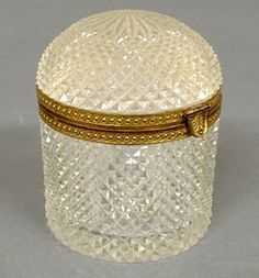 An nusual round French cut crystal dome-lid box, circa 1920, bronze gilt banding