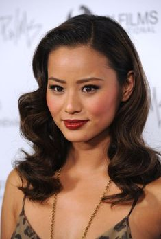 Actress Jamie Chung, love this makeup for bridal. Warm bronze face, classic makeup with brick red lipstick. Good for brides tan to dark skin, Asian or other women of color.