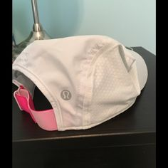 Lululemon Athletica Hat Authentic lululemon athletica Race to Place Run Hat; one size; white with hot pink trim; worn only a few times; lightweight; no trades. lululemon athletica Accessories Hats