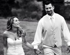 Bride and Groom enjoying their wedding day while walking through our scenic fields!
