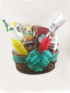 """Product ID # 5013    This gift basket has everything the back yard BBQ needs, What a gift! The basket comes with an apron, mitt, matching towel, BBQ table cloth, BBQ tool set, condiment set, baster, 4 different flavors of BBQ sauces, Weber marinade mix, 2 flavors of mustard, a hamburger maker and water sprayer. Great for Dad's birthday, Father's Day, Mother's Day, corporate gift, or just plain summer fun.  This basket is 18""""x 12""""x 17""""."""