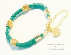 """Love this turquoise color hand braided soft deerskin leather bracelet with 18k gold overlay Balinese style embellishments by Alexandra Marshall. Magnetic clasp w/safety chain. 6 1/2"""". #B2226. $32.  To order double click photo."""