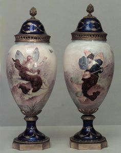 Pair of French Art Nouveau enamal and Sevres porcelain vases with cover having a scence of a winged woman with a bronze finial and base (as is-repairs to base)