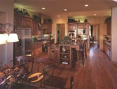 Toll Brothers Family room with open-beam ceiling. Duke Model ...