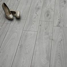 The Timeless Oak Grey laminate floor has a refined appearance that blends a realistic wood effect design with an elegant neutral tone to offer the best of both worlds. As charming and striking as solid wood, this laminate floor is both more affordable and Herringbone Laminate Flooring, Cost Of Wood Flooring, Flooring On Walls, Laminate Flooring Colors, Direct Wood Flooring, Cleaning Wood Floors, Engineered Wood Floors, Stone Flooring, Flooring Ideas