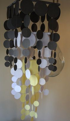 Ombre paper chandelier with a wooden frame wrapped in ribbon