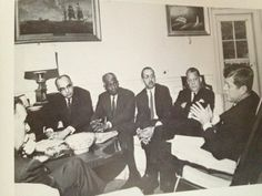 Former Morehouse College president, Benjamin E. Mays and many others meeting with President John F. Kennedy in the Oval Office