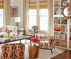 I love how they used the color pink and repeated it throughout the room in varying fabric colors and pattern.