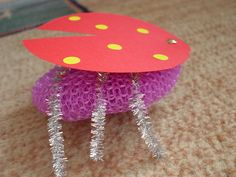 Lady bug, pipe cleaners, sticky dots, plastic scrub