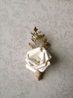 Hey, I found this really awesome Etsy listing at https://www.etsy.com/listing/151449893/white-book-page-boutonniere