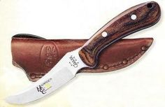 We can put your Logo on this Case Rosewood Ridgeback Hunter Knife: http://www.logo-knives.com/case-398-rosewood-r-hunter.html