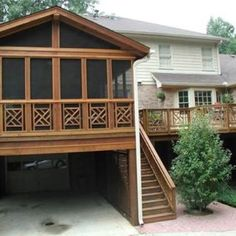 Cedar was used to create this screened porch over the lake side garage access.  Artistic rail design compliments the adjoining deck that was built at the same time.