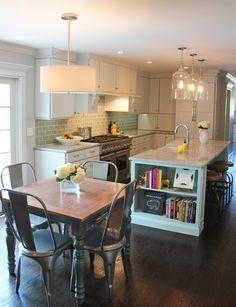 drum shade pendant light in kitchen, tolex metal chairs, green glass backsplash in kitchen http://www.mbzinteriors.com