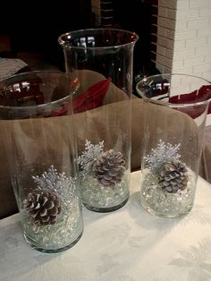 ~ love the simplicity of this winter decor. Dollar Store marbles, vases, glittered snowflakes,  pinecones. *