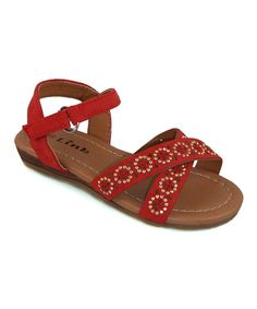 Little ladies will love the airy feel of these fabulously stylish sandals. An adjustable hook and loop strap seals this posh pair around ankles, while a unique rhinestone design adds an artsy appeal that works with all sorts of ensembles.