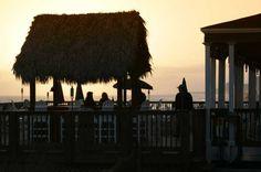 Enjoy a beautiful Destin sunset and cocktails at the Henderson Park Inn Tiki bar.
