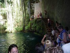 People lined up waiting to dive into the cold water of the Ik Kil Cenote near Chichen Itza, Mexico.   Go to www.YourTravelVideos.com or just click on photo for home videos and much more on sites like this.