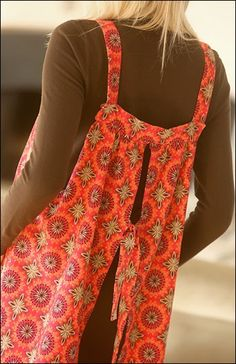 BACK VIEW - Easy-On Apron sewing pattern – IJ960 - is a classic simple shape that can be made as great kitchen wear, a fun topper for leggings or jeans, or even a swim cover-up! Choose cotton or corduroy in a fun print to put some whimsy in your wardrobe. Easy to make & easy to wear with back ties & large pockets. One size fits most. From IndygoJunction.com