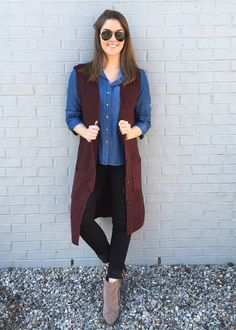 Calling all fashion girls. This long burgundy sweater vest is the coolest layering piece that you wardrobe is begging for. Throw it on over practically anything and you're instantly chic!