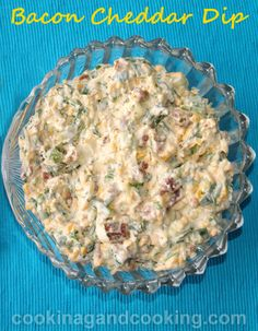 This tasty bacon dip recipe is a perfect addition to your next party. Bacon cheddar dip made with bacon bites, cheddar cheese, green onion, fresh cilantro, slivered almonds, mayo and yogurt.