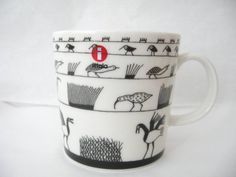 Iitala Finland. Oiva Toikka Anniversary Birds mug, grey. In celebration of more than 50 years of Toikka's work at Arabia Pottery and Nuutajarvi glass works. In 1992 he became the first recipient of the Kaj Franck Design Prize for his contribution to the art of glass, and design in general.