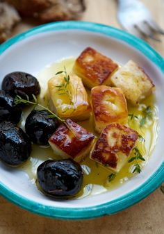 Halloumi cheese fried with olives, olive oil and herbs is a quick and delicious appetizer!
