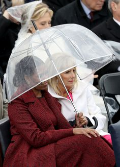 WASHINGTON, DC - JANUARY 20:  Michelle Obama and Dr. Jill Biden sit under an umbrella on the West Front of the U.S. Capitol on January 20, 2017 in Washington, DC. In today's inauguration ceremony Donald J. Trump becomes the 45th president of the United States.  (Photo by Joe Raedle/Getty Images) via @AOL_Lifestyle Read more: https://www.aol.com/article/news/2017/01/25/obamas-vacation-british-virgin-islands-post-inauguration/21662186/?a_dgi=aolshare_pinterest#fullscreen