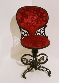 Love this red brocade and black iron chair!