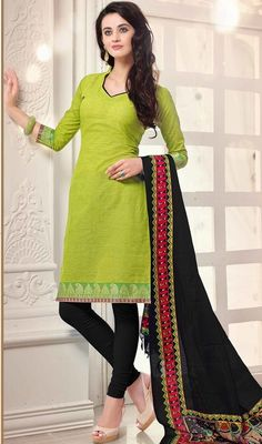 Define gorgeousness with this lime green color cotton churidar suit. This charming attire is showing some great embroidery done with lace work. #parrotgreencottondress #cottondresscollection #fancysuit