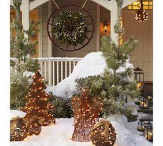 Lit Faux Pine & Red Berry Wreath (299.00) // Lit Twig Globe (49.00-69.00)