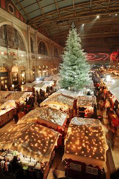 There is an incredible Christmas Market located in the main train station in Zürich, Switzerland. In the middle of the market is a beautiful Christmas tree completely decorated with Swarovski ornaments.