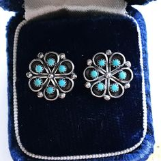 Perfection - lovely flower cluster turquoise stud earrings. Done in a Native American southwestern style, each earring has six turquoise stones bezel set against a darkened patina backdrop. These vintage beauties have a great bohemian flair; they are small enough to be everyday pieces, but large enough to add a splash of color to any outfit.  HISTORY: Newer vintage, estimated 1970s  MATERIALS: Sterling silver, turquoise  SIZE: The diameter of each stud measures 1/2. CONDITION: Excellent....