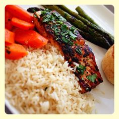 Orange pepper seared salmon with balsamic and wild flower honey gastrique, carrots, grilled asparagus and rice.