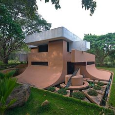 House in Auroville, India, designed by Roger Anger