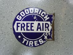 Very cool original Goodrich TIres double sided porcelain flange sign.