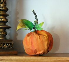 How to make a Paper Bag Pumpkin - Here's a simple and fun step-by-step tutorial that you can do with ( or without ) your kids. It's one of many great art and craft projects from Gail Bartel at ThatArtistWoman.org