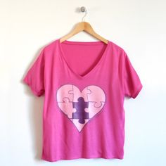 Piece of My Heart Ladies T-Shirt in Berry – Perfect for the mom who constantly gives of her heart to those around her. And for all of those littles that make her heart complete, check out our coordinating puzzled tee.  Available in 3 fit options: fitted crew, fitted v-neck and loose v-neck on cloudandclover.com