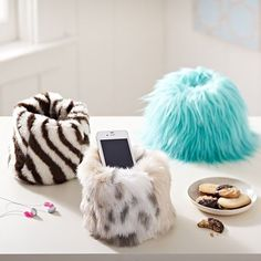 Furry cell phone holder... for the girl who has everything! I think these are so funny.