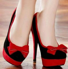 Black and red wedding shoes with red bows if I did not have the shoes picked out I was going to were these would have to be in the running