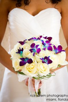 the orchid looks like butterflys <3 Google Image Result for http://www.miamiphotographer.net/pinterest/images/bouquets/white-roses-purple-orchids-bouquet.jpg