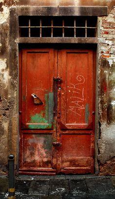 Old door with MALIK carved into it, in Pisa, Italy. - by Francesco Del Santo