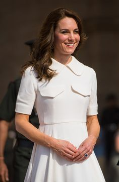 Catherine, Duchess of Cambridge smiles after laying a wreath to honour the soldiers from Indian regiments who served in World War I at India Gate on April 11, 2016 in New Dehli, India.