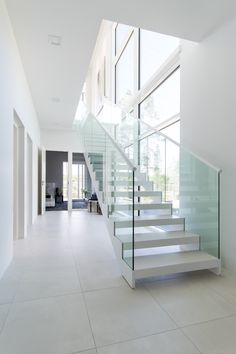 White Grado KIDE stairs in Finnish home. Stainless Steel Staircase, Interior And Exterior, Interior Design, Modern Stairs, Stair Steps, Stair Storage, House Rooms, Stairways, Living Spaces