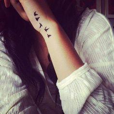Birds on wrist tattoo
