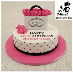 A white and pink black quilted birthday cake with a Prada shopping bag on top by It's Mine Cakes