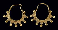 A PAIR OF ROMAN GOLD EARRINGS   SYRIA, CIRCA 1ST-2ND CENTURY A.D.   Formed from a plain hoop tapering to a hook-and-loop closure, the lower portion decorated on one side with a band of granulation and a plain wire, joined below to granulated triangles with a hollow ball at each tip, framed on either side by a hollow ball
