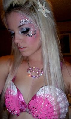 Mermaid makeup:  Mermaid costume and make up #Halloween #temporarytattoos (Mia would definitely like the sparkly makeup, and rhinestones in the starfish definitely add glam-L)