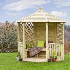 This beautifully designed open-sided octagonal gazebo has a solid tongue and groove panel at the back with diamond trellis to either side and balustrade sections each side of the entrance.